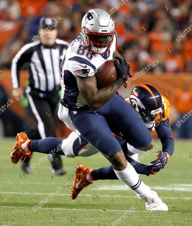New England Patriots tight end Martellus Bennett (88) runs as Denver Broncos free safety Darian Stewart defends during the first half of an NFL football game, in Denver