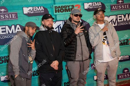 Members of Kurupt FM pose for photographers upon arrival at the MTV European Music Awards 2017 in London, Sunday, Nov. 12th, 2017
