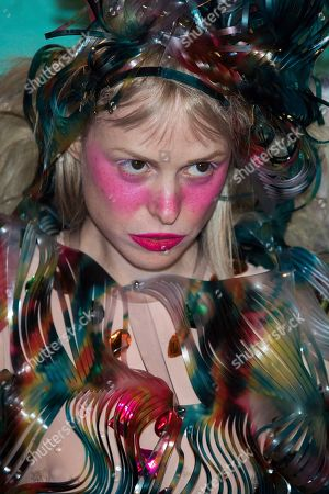 Petite Meller poses for photographers upon arrival at the MTV European Music Awards 2017 in London, Sunday, Nov. 12th, 2017