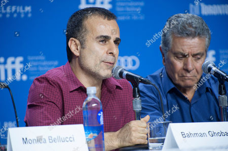 "Director/writer/producer Bahman Ghobadi, left, and actor Behrouz Vossoughi participate in a photo call and press conference for the film ""Rhino Season"" at TIFF Bell Lightbox during the Toronto International Film Festival, in Toronto"
