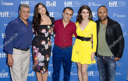 "Actor Behrouz Vossoughi, from left, actress Monica Bellucci, director/writer/producer Bahman Ghobadi, actress Belçim Bilgin and actor Arash Labaf participate in a photo call and press conference for the film ""Rhino Season"" at TIFF Bell Lightbox during the Toronto International Film Festival, in Toronto"