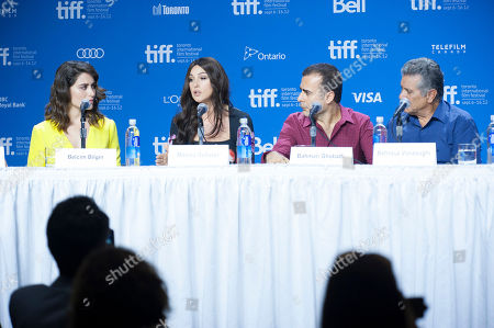 "Actresses Belçim Bilgin, from left, and Monica Bellucci, director/writer/producer Bahman Ghobadi, and actor Behrouz Vossoughi participate in a photo call and press conference for the film ""Rhino Season"" at TIFF Bell Lightbox during the Toronto International Film Festival, in Toronto"