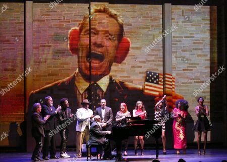 Stock Photo of Ellis Hall performs at Backstage at the Geffen, in Los Angeles. Bryan Cranston is seen onscreen