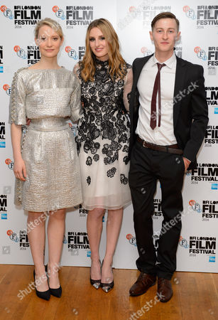 From left, Australian actress Mia Wasikowska, British actress Laura Carmichael and British actor Luke Tittensor pose for photographers at the premiere of Madame Bovary at a central London cinema, during the BFI London Film Festival, London