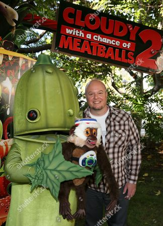 """Director Cody Cameron poses characters during a press day event for the movie """"Cloudy With A Chance Of Meatballs 2"""" held at Sony Pictures Animation, in Culver City, California"""