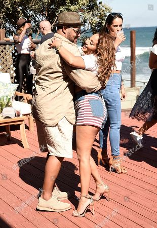 Singer Adrienne Bailon, right, Israel Houghton spend the day at the Kia Beach House presented by Teva Sandals on in Malibu, Calif