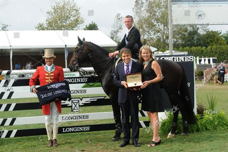 Juan-Carlos Capelli and Jennifer Judkins, of Longines, present Richie Moloney, of Ireland, with a Longines timepiece after Moloney won the $40,000 Longines Cup at the Hampton Classic, in Bridgehampton, NY. Longines is the official watch and timekeeper of the 38th annual Hampton Classic