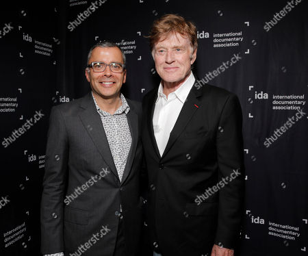 IDA Awards Co Producer James Cofta and Robert Redford at the International Documentary Association's 2014 IDA Documentary Awards at Paramount Studios on in Los Angeles