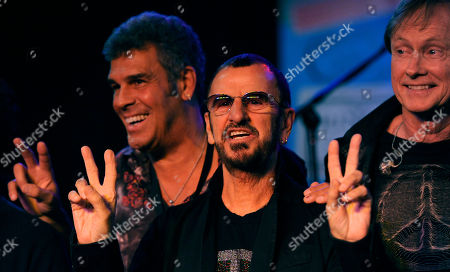 Ringo Starr, center, poses with his All Starr Band members Mark Rivera, left, and Richard Page following a news conference at SIR studios, in Los Angeles. Starr announced another leg of 2013 tour dates in Latin America and the U.S