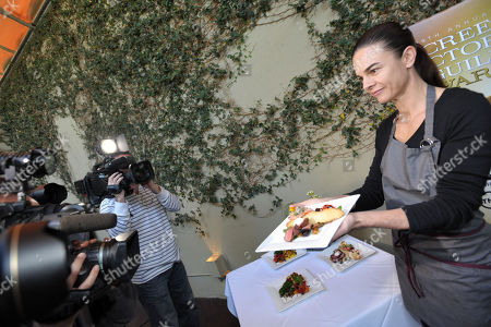 Stock Image of Chef Suzanne Goin poses for photographers at the Screen Actor's Guild Awards menu tasting event at Lucques restaurant, in Los Angeles