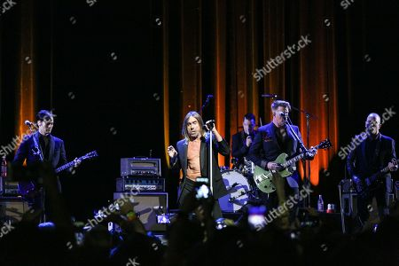 Iggy Pop, center, performs with Michael Shuman, Josh Homme, and Jon Theodore, right, at ACL Live at The Moody Theater during South By Southwest, in Austin, Texas