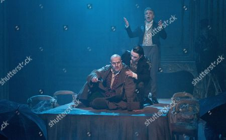 Chris Ellison as Magwitch, centre left, Taylor Jay-Davies as Young Pip, centre, and Paul Nivison, centre right, perform a scene from the Great Expectations, during a theatre photo call at the Vaudeville Theatre, central London, . Based on the novel of the same name by Charles Dickens, the stage adaptation by Jo Clifford runs in the West End from February