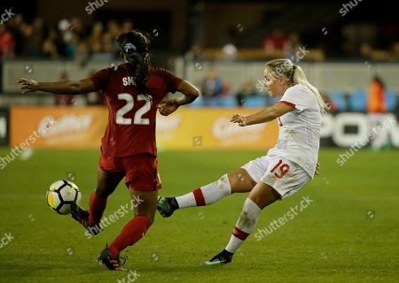 Stock Photo of Adrianna Leon, Taylor Smith. Canada forward Adrianna Leon (19) and United States defender Taylor Smith (22) during the second half of an international friendly women's soccer match, in San Jose, Calif