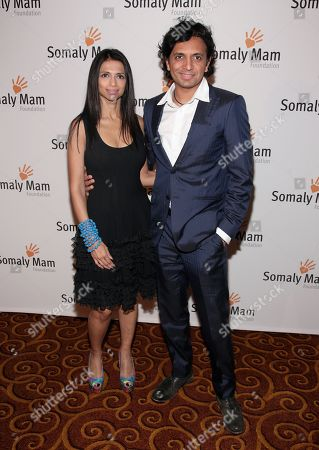 Director M. Night Shyamalan, right, and his wife, psychologist Bhavna Vaswani, left, attend the Somaly Mam Foundation Gala on in New York