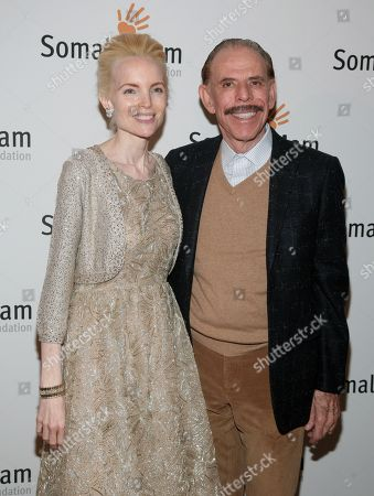 Artist Peter Max, right, and his wife Mary Max, left, attend the Somaly Mam Foundation Gala on in New York