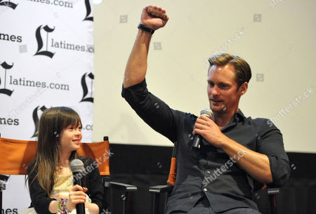 """Stock Image of Onata Aprile, left, and Alexander Skarsgard appear on stage during the Q&A for the LA Times Screening of """"What Maisie Knew"""" on in North Hollywood, Calif"""