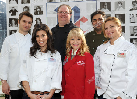 Stock Photo of McCormick Executive Chef Kevan Vetter, center second row, joins celebrity chefs Alex Stupak, Claire Robinson, Kelsey Nixon, Suvir Saran and Donatella Arpaia, left to right, to celebrate McCormick's 125th anniversary and to launch McCormick's Flavor of Together program, in New York. Visit FlavorofTogether.com to share your flavor story