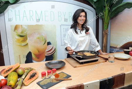 """Claire Robinson, host of Food Network's """"5 Ingredient Fix,"""" demonstrates a smoky Brazilian Farofa topping, inspired by the McCormick Flavor Forecast 2014: 125th Anniversary Edition at McCormick's official launch of their 125th anniversary and Flavor Forecast 2014, in New York"""