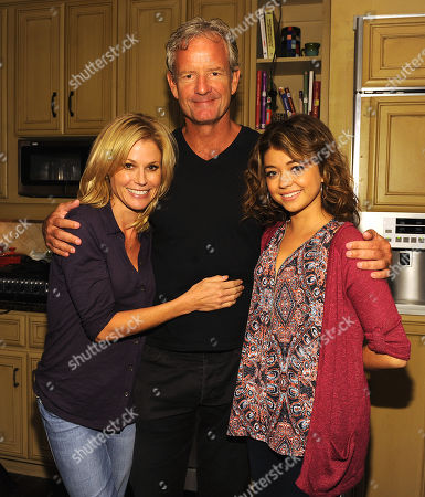 "From left, ""Modern Family"" cast member Julie Bowen, co-creator/executive producer Chris Lloyd and cast member Sarah Hyland celebrate the 100th episode of the Emmy award-winning comedy series, during a celebratory champagne toast on the show's soundstage,, in Los Angeles, Calif"