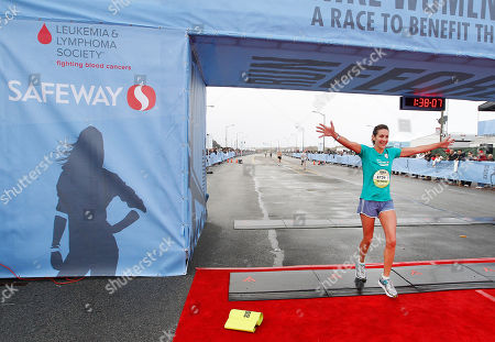 Summer Sanders, Olympic Gold Medalist, finishes strong for Team Safeway at the Nike Women's Marathon in San Francisco on . Sponsored by Safeway, the Nike Women's Marathon is the largest women's marathon in the world with 25,000 runners