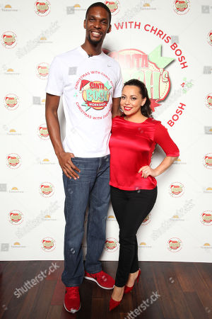 The Miami Heat's Chris Bosh and wife Adrienne Williams Bosh arrive at Team Tomorrow Inc. Celebrates Christmas at Santa Bosh's Workshop on at Lucky Strike Lanes in Miami Beach, FL