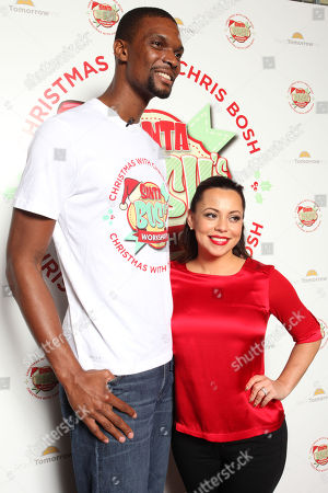 The Miami Heat's Chris Bosh and wife Adrienne Williams Bosh arrive at Team Tomorrow Inc. Celebrates Christmas at â?œSanta Boshâ?™s Workshopâ?? on at Lucky Strike Lanes in Miami Beach, FL