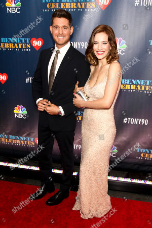 """Michael Buble, left, and Luisana Lopilato, right, attend """"Tony Bennett Celebrates 90: The Best Is Yet to Come"""" at Radio City Music Hall, in New York"""