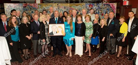 "Stewart F. Lane - aka ""Mr. Broadway, Bonnie Comley and Jacquie Moloney (front center) pose with attendees at UMass Lowell Celebration of Sardi's Caricature of Stewart F. Lane & Bonnie Comley at Sardi's on"