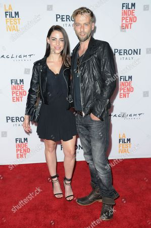 "Jessica Lowndes, left, and Joe Anderson attend ""Abattoir"" premiere held at ArcLight Cinemas, in Culver City, Calif"