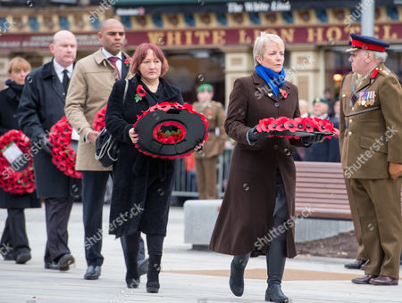 Stock Photo of Remembrance Sunday at the Cenotaph in Bristol. Kerry McCarthy MP (red hair) takes a wreath to the Cenotaph.