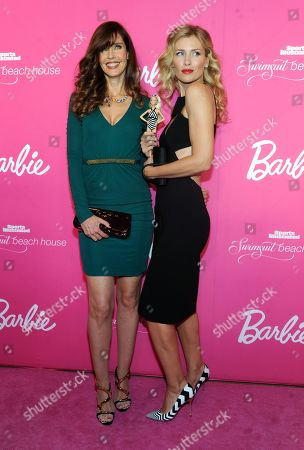 Model Carol Alt, left, and Daniela Pestova attend the Barbie and Sports Illustrated Swimsuit 50th anniversary celebration of the Sports Illustrated Swimsuit legends, in New York