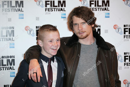 Actors Corey McKinley and Jack O'Connell pose for photographers upon arrival at the premiere of the film 71 during the BFI London Film Festival in central London