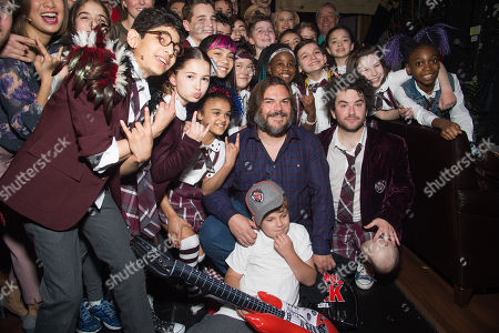 """Actor Jack Black, center, and his son Samuel Black, center bottom, meet backstage with cast members of Broadway's """"School of Rock"""" after watching a performance at the Winter Garden Theatre on Sunday, May, 1, 2016, in New York"""