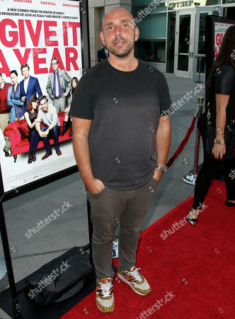 """Dan Mazer arrives on the red carpet at a special screening for """"I Give It A Year"""" at the on in Los Angeles"""