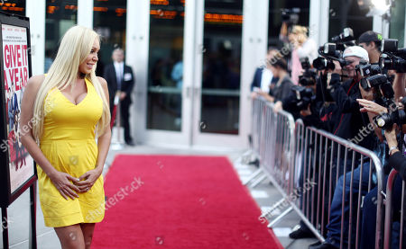 """Mary Carey arrives on the red carpet at a special screening for """"I Give It A Year"""" at the on in Los Angeles"""