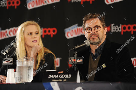 Janet Varney, left, and Dana Gould speak onstage during the Stan Against Evil NY Comic Con Panel at Javits Center, in New York