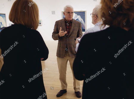 "In this Wed., Oct. 7, 2015, photo, actor-comedian and curator Steve Martin, center, conducts an exhibition walk through along with co-curators, Andrew Hunter, Cynthia Burlingham, and Director of The Hammer Museum, Ann Philbin, in a gallery for the exhibition ""The Idea of North: The Paintings of Lawren Harris"" at The Hammer Museum in in Los Angeles. The show opens"