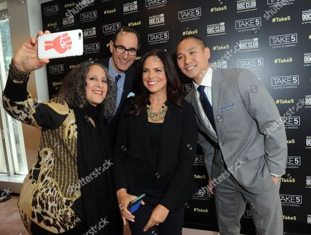 Panelist Gina Belafonte, left, takes a selfie with Josh Sapan, second left, President & CEO, AMC Networks, moderator Soledad O'Brien and Marcus Lee, GM, SundanceNow Doc Club, before the SundanceNow Doc Club Take5 Justice in America panel, at The Paley Center for Media in New York. Take5 is a collection of five 5-minute short films exploring social justice issues. The series is available to view and share for free on DocClub.com beginning May 17th