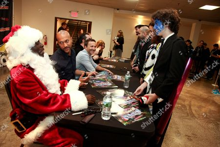 Stock Photo of Actors Gary Anthony Williams, from left, Keegan-Michael Key and Breckin Meyer are seen with fans at the SuperMansion: War On Christmas - NYCC at the Hammerstein Ballroom, in New York