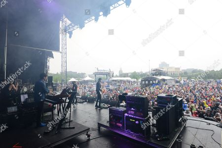 Stock Image of Mikel Jollett, Noah Harmon, Anna Bulbrook, and Steven Chen with The Airborne Toxic Event performing at the Shaky Knees Music Festival, in Atlanta