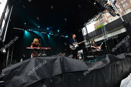 Mikel Jollett, Noah Harmon, Anna Bulbrook, and Steven Chen with The Airborne Toxic Event performing at the Shaky Knees Music Festival, in Atlanta