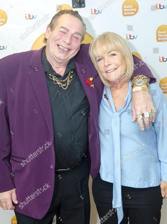 Bobby George and Linda Robson
