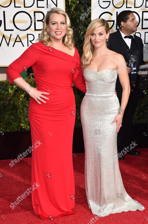 Cheryl Strayed, left, and Reese Witherspoon arrive at the 72nd annual Golden Globe Awards at the Beverly Hilton Hotel, in Beverly Hills, Calif