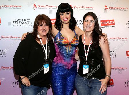 "Stock Photo of Global pop star Katy Perry, center, with local teachers, left to right, Lori Goldstein and Cara Koloshinsky backstage at the CONSOL Energy Center during her Prismatic World Tour performance on in Pittsburgh. Staples teamed up with superstar Katy Perry to ""Make Roar Happen"" and celebrate and support teachers during the back-to-school season by donating $1 million to DonorsChoose.org, a charity that has helped fund more than 450,000 classroom projects for teachers and impacted more than 11 million students"
