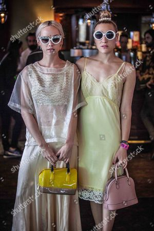 IMAGE DISTRIBUTED FOR FILTERLESSCO - From left, Margot Moretti and Mia Moretti of The Dolls pose for a photo at The Naked Grape Wines Presents The Music Box at the Cedar Door during 2014 SXSW on in Austin, Texas