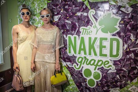 From left, Mia Moretti and Margot Moretti of The Dolls pose for a photo at The Naked Grape Wines Presents The Music Box at the Cedar Door during 2014 SXSW on in Austin, Texas