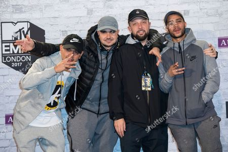 Members of Kurupt FM pose for photographers backstage at the MTV European Music Awards 2017 in London, Sunday, Nov. 12th, 2017