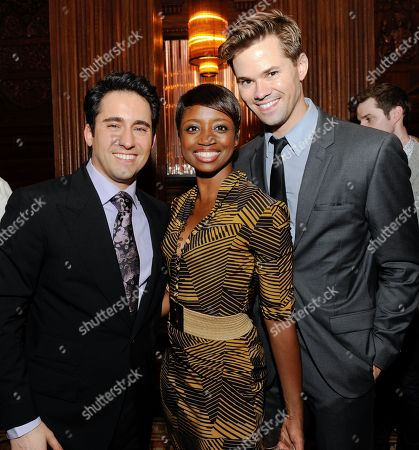 Stock Image of Actors John Lloyd Young, Montego Glover and Andrew Rannells pose together at cocktail reception at the Angelo Galasso Boutique a nd The Oak Room at The Plaza on in New York