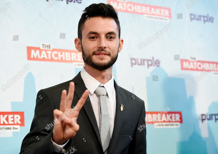 """Wesley Elder, a cast member in """"The Matchbreaker,"""" mimics the favorite gesture of late cast member Christina Grimmie at the premiere of the film at the ArcLight Cinerama Dome, in Los Angeles. Grimmie, a singer on the television singing competition series """"The Voice,"""" was shot and killed while signing autographs and meeting fans following a concert in June in Orlando, Fla"""