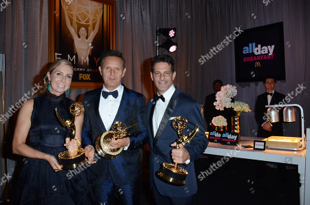 """Stock Photo of Audrey Morrissey, Mark Burnett and Lee Metzger with the awards for Outstanding Reality - Competition Program for """"The Voice"""" backstage at the 67th Primetime Emmy Awards, at the Microsoft Theater in Los Angeles"""
